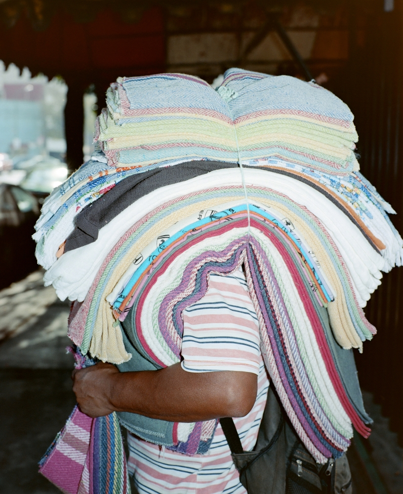 man selling towels, Mexico City, 2016