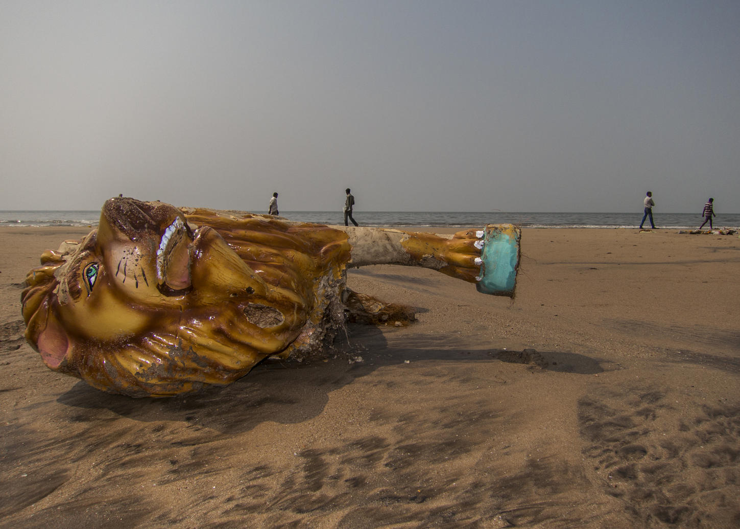 A broken idol lies on the beach after a festival, Mumbai, IND